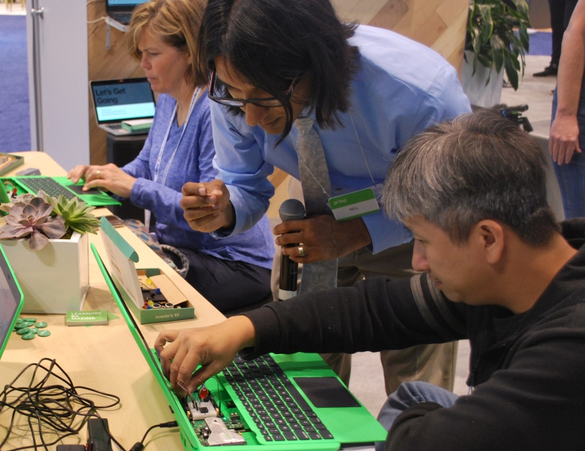 Neil Mittal helping a ISTE attendee build using a pi-top